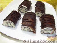 Фото к рецепту: Шоколадные рулетики из блинов