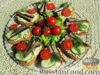 Фото приготовления рецепта: Бутерброды со шпротами - шаг №9