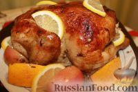 Фото к рецепту: Курица, запеченная с яблоками и апельсинами