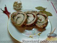 Фото к рецепту: Мясной рулет из свиного подчеревка со шпинатом