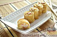 Фото к рецепту: Роллы из блинчиков с крабовыми палочками