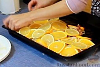 Фото приготовления рецепта: Курица, запеченная с травами и цитрусами - шаг №10