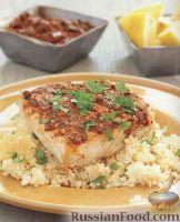 Фото к рецепту: Рыба, приготовленная с кус-кусом