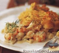 Фото к рецепту: Морепродукты, запеченные с картофелем