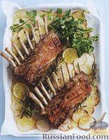Фото к рецепту: Бараньи ребрышки, жаренные с картофелем в духовке