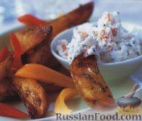 Фото к рецепту: Жареный картофель с сырным соусом
