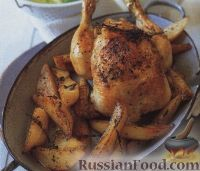 Фото к рецепту: Курица, жаренная в духовке с картофелем