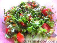 Фото к рецепту: Салат с нутом, рукколой и помидорами черри