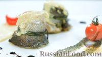 Фото к рецепту: Рулеты из сибаса с сушеными помидорами