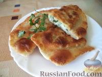 Фото к рецепту: Жареные пирожки с яйцом, луком и зеленью