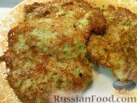 Фото к рецепту: Кабачковые оладьи с сыром и чесноком