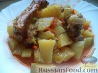 Фото к рецепту: Рагу из свиных ребрышек, с картофелем и кабачками