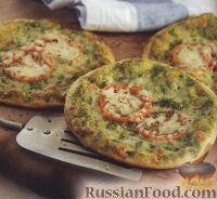 Фото к рецепту: Пицца с соусом песто, помидорами и моцареллой