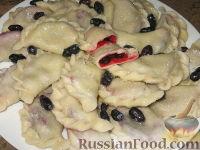 Фото к рецепту: Вареники с жимолостью
