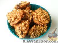 Фото к рецепту: Овсяное печенье с курагой и изюмом