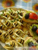 """Фото к рецепту: Закуска """"Пчелы"""" (блинчики с творожной начинкой)"""