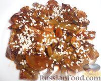 Фото приготовления рецепта: Жареные огурцы по-китайски - шаг №9