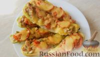 Фото к рецепту: Молодые кабачки с фаршем, помидорами и сыром