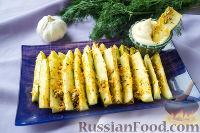 Фото к рецепту: Кабачки, запеченные в духовке, с сыром и специями