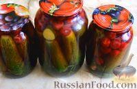 Фото к рецепту: Огурцы, маринованные с вишней, на зиму