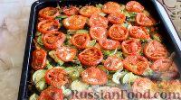 Фото к рецепту: Караси, запеченные в духовке, с овощами