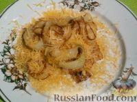 Фото к рецепту: Луковые кольца с сыром