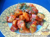 Фото к рецепту: Кабачки, тушенные в томатном соусе