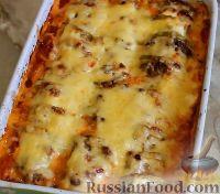 Фото к рецепту: Кабачки, запеченные в духовке, с фаршем и рисом
