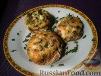Фото к рецепту: Фаршированные сыром и яйцами шампиньоны