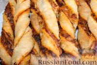 Фото к рецепту: Острые сырные палочки из слоеного теста