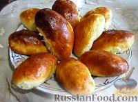 Фото к рецепту: Пирожки со сливами (в духовке)