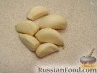 Фото приготовления рецепта: Закуска из кабачков с чесноком и помидорами - шаг №4