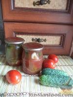 Фото к рецепту: Огурцы консервированные в томатном соке