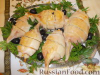Фото к рецепту: Кальмары, фаршированные рисом и овощами