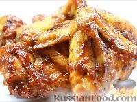 Фото к рецепту: Куриные крылышки в медово-соевом соусе