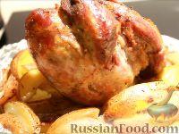 Фото к рецепту: Запеченная телячья ножка с картофелем