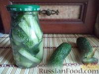 Фото к рецепту: Салат из огурцов в собственном соку
