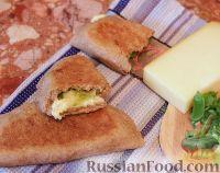Фото к рецепту: Цельнозерновая лепешка с сыром и зеленым луком