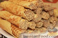 Фото к рецепту: Вафельные трубочки со сгущенкой