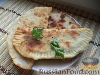 Фото к рецепту: Манзари (пирожки с творогом и зеленью)