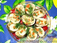 Фото к рецепту: Рулетики из минтая с овощами и сыром