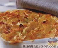 Фото к рецепту: Картофель, запеченный с луком пореем и сыром