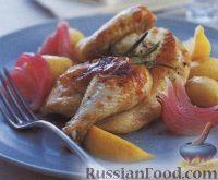 Фото к рецепту: Цыплята, запеченные с картофелем