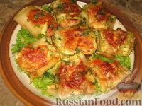 Фото к рецепту: Рыба в кабачке