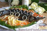 Фото к рецепту: Осетр, запеченный в духовке, с овощами