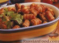 Фото к рецепту: Колбаски в беконе
