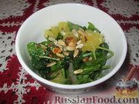 Фото к рецепту: Салат из шпината с апельсином и орешками