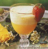 Фото к рецепту: Коктейль из апельсинового сока и консервированного ананаса