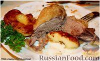 Фото к рецепту: Утка, тушенная в яблоках, с жареной Антоновкой