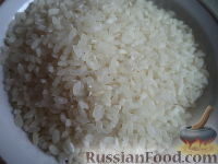 Фото приготовления рецепта: Каша рисовая молочная - шаг №2